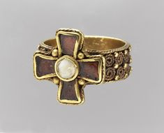 Gold Frankish Finger Cross, c. 450 - 525 Note swirls of rebirth and regeneration on band.
