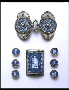 Buckle and buttons:   Etruria, England (probably, made)  ca. 1810,   Josiah Wedgwood and Sons (maker)    Materials and Techniques:  Jasper ware and back-painted glass, mounted in cut steel and painted.