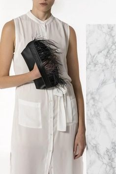 Bring a glamorous edge to your evening look with the Domna design clutch. Handmade of fine quality calf leather and silky feathers, it comes in 3 colors, black, camel/brown (waxed tan) and nude (nubuck). Greek Chic Handmades Women's bags are handcrafted in Athens, Greece from genuine leather. Shop your favorite leather bag to accompany your handmade sandals. Most importantly we use the same premium leather we built the sandals with and the impeccable local craftsmanship. Black Clutch Bags, Leather Clutch Bags, Black Leather, Black Camel, Calf Leather, Evening Outfits, Leather Bags Handmade, Lace Up Sandals, Bohemian Style