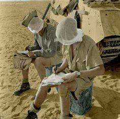 British Crusader tank crewman trying to write in the western desert, N. Africa