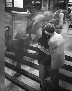 What a great idea, kissing couple by a moving crowd with a slow shutter speed.