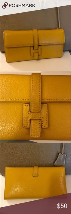 Mustard pebbled leather H wallet In great condition! Lots of slots and pockets and places to store everything! Only wear is at the top corners and it really isn't noticeable at all! Price reflects wear and authenticity. One of the best I've seen! From a pet free and smoke free home. Hermes Bags Wallets