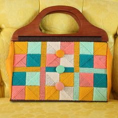 I love the look of vintage needlepoint (especially needlepoint handbags!) from the '50s, '60s and '70s, and wanted to try my hand at needlepoint myself. So I grabbed some plastic canvas, got to stitching, and soon realized: needlepoint is pretty easy!