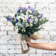 purple, white and blue bouquet against a white brick wall My Flower, Wild Flowers, Beautiful Flowers, Rustic Flowers, Beautiful Things, Bouquet Champetre, Plants Are Friends, Floral Arrangements, Flower Arrangement