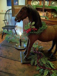 Antique Christmas-am thinking of doing this with the wooden rocking horse my grandkids have out grown Primitive Christmas Decorating, Primitive Country Christmas, Prim Christmas, Antique Christmas, Little Christmas, All Things Christmas, Winter Christmas, Christmas Decorations, Primitive Decor