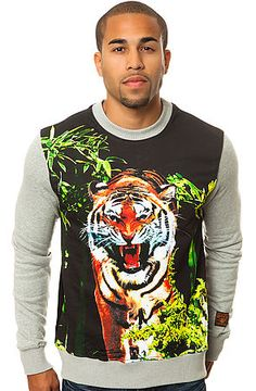 This crewneck sweatshirt features an allover multicolor tiger print with a graphic detail on the back shoulder, contrast sleeves, and a logo tag above the cuff.  $68