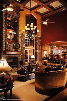 Love the mix of brick, stone, wood - fireplace, windows, ceiling.
