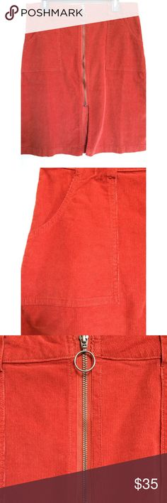 "Corduroy A-Line Red/Orange Skirt Visually sculpt an hourglass figure in a retro-cool A-line skirt cut from soft, fine-wale corduroy with oversized patch pockets and a round metallic zipper pull.  Size 12 length 24"" Waist 16.5"" Front zip closure Front patch pockets; back patch pockets Front slit 99% cotton Sun & Shadow Skirts A-Line or Full"