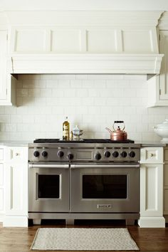KITCHEN: My favorite hood- ours will have  cabinets above... will this look like too much, or amazing? Wolf Range 48""