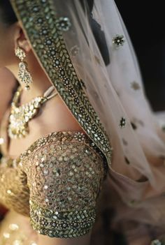 Detail of Indian wedding dress | One Couple's Lavish Four-Day Indian Wedding In Bali | http://www.bridestory.com/blog/one-couples-lavish-four-day-indian-wedding-in-bali