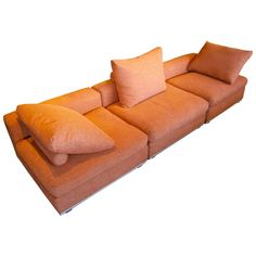 Stylish Three-Part Armless Sectional Sofa With Tubular Aluminum Base  C. 1990s   From a unique collection of antique and modern sofas at https://www.1stdibs.com/furniture/seating/sofas/