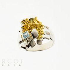 PK-ES521 Artystyczny pierścionek z topazem niebieskim