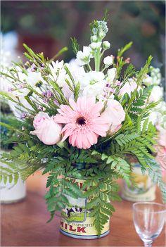 Rustic flower vase with ferns - http://www.weddingchicks.com/2012/09/27/rustic-wedding-reception-ideas/