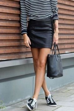 Dress your stripes and leather down with your fave kicks