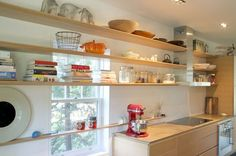 Open shelving is perfect for storing and displaying spice jars and cookbooks