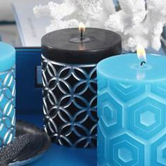 Set+of+four+embossed+pillar+candles+with+Moroccan-inspired+silver+detail.+  Product:+Pillar+candleConstruction+Material:+