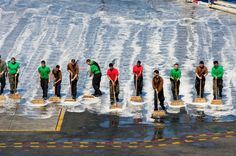 Sailors perform a flight deck wash down aboard the aircraft carrier.
