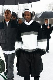 WINTER SPORTS: A$AP Rocky wearing Shaun Samson AW13 Earmuffs, Oversized Top, and Shorts at Dior Couture Spring 2013 Runway Show