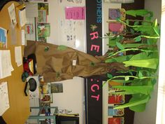 So we have a thread about classroom themes, but what about a library theme? Most people continue their classroom theme, I guess, but I'm doing a bunch. Elementary Library Decorations, School Library Displays, Library Themes, School Decorations, Rainforest Classroom, Jungle Theme Classroom, Classroom Themes, Brazil Rainforest, Rainforest Theme