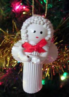 Noodle angel ornament. I have one of these that I made with my Grams as a very little girl, it hangs in my kitchen year around. . . keeps me from burnin' the joint down!!