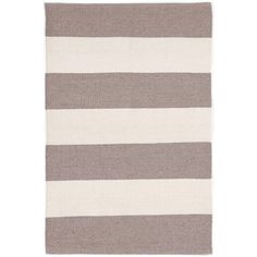 """Test drive this rug in your space.Order a swatch by adding it to your cart.Both durable and sophisticated, this eco-friendly indoor/outdoor rug, featuring a classic chunky stripe in a beachy hue, is at home in any room of the house. Part of our Bunny Williams collection. Due to the handmade nature of this area rug, variations in color are expected.Made of 100% PET, a polyester fiber made from recycled plastic bottles.   • Stripes run the width of the rug and are 5"""" wide"""