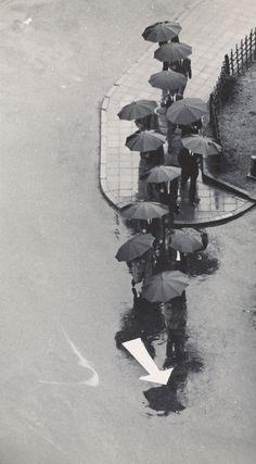 Rainy Day, Tokyo; André Kertész (American, born Hungary, 1894 - 1985); Tokyo, Japan; September 14, 1968; Gelatin silver print; 24.7 x 13.7 cm (9 3/4 x 5 3/8 in.); 84.XM.193.20; J. Paul Getty Museum, Los Angeles, California