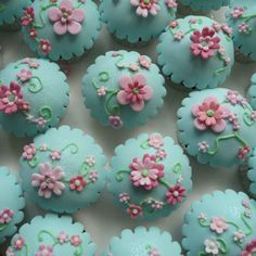 Turquoise flower cupcakes.  Both tasty and beautiful!