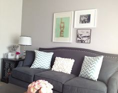 I LOVE gray with light colors. This is an awesome layout for this room! See how the green/white pops on the wall? :)