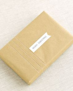 pleated & stitched brown paper package w/ simple tag