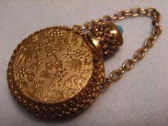 VINTAGE VANITY - SMALL 4cm EMBOSSED GOLD TONE ENCASED GLASS SCENT PERFUME BOTTLE