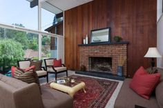 Retro mid-century modern living room with wood paneling. So much potential here - at 6406 Oakwood Drive in Oakland.