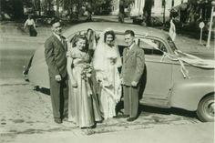 Vintage wedding real photo postcard - bride and groom, best man and maid of honor and decorated honeymoon car, circa 1940's.
