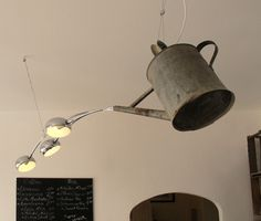 Watering can transformed into a chandelier #RepurposedWateringCan, #WateringCanChandelier