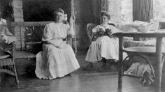 """Sugar Pine Point, Tahoe :  From Frances Dinkelspiel blog: """"This is a picture of my great great grandmother, Esther Hellman, and her daughter Clara Hellman Heller, relaxing on the porch of their summer home, Pine Lodge.You can't see it, but they are looking out at a magnificent view of Lake Tahoe. They look so relaxed here, sitting on wicker furniture in their white cotton dresses, sipping tea, and hanging out with their dogs. This picture was probably taken in 1903"""""""