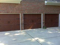 Three Single Dark Wood Grain Carriage House Garage Doors