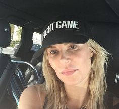 Brandi Glanville wearing no makeup and a hat that says Fight Game