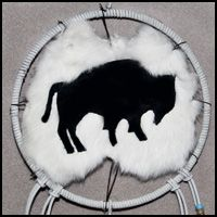 "This unique, authentic Native American dreamcatcher contains 2 leather-covered hoops measuring 9"" across. The top hoop contains a white rabbit skin with a buffalo silhouette. Colorful beads and seafoam green feathers strike the perfect balance. Don't miss your chance to win it this month - May 2014!  http://www.nrcprograms.org/site/PageServer?pagename=remember_dreamcatcher_giveaway #native #dreamcatcher"
