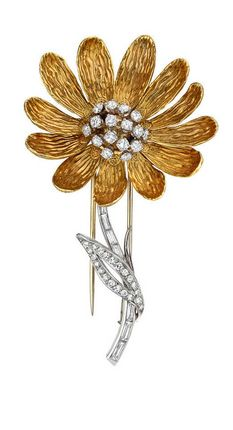 """Boucheron Gold & Diamond Daisy Brooch, Daisy brooch, the flower with textured 18k yellow gold petals centering upon a cluster of circular-cut diamonds, resting on a baguette-cut and circular-cut diamond-set leaf and stem, the diamonds weighing approximately 2.60 total carats, numbered 15193, circa 1950's, signed Boucheron Paris. 2.5"""" length and 1.5"""" width at widest point."""