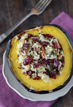 Super Easy 30 Minute Stuffed Acorn Squash... grab some rice, any dried fruit and any nuts... add spices, voila!