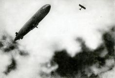 First World War, aerial war. A French zeppelin/airship under attack from a German plane. 1915.