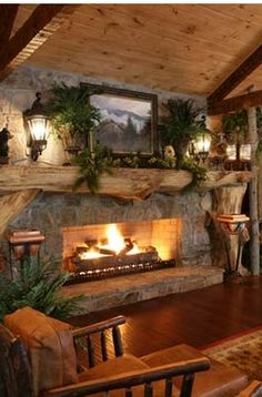 rustic dreamy fireplace in the family room. - you can make this behind the earth stove...