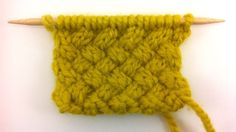 The Woven Cable knit stitch.  I see a handbag or clutch with this pattern.  Or a cowl.  Or...  I'm making a list!