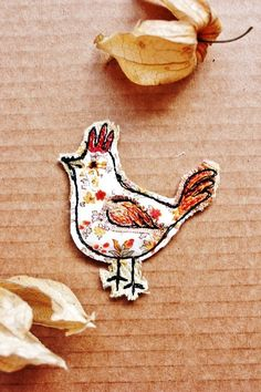 Handmade textile chicken brooch made by Lotus Blossom.