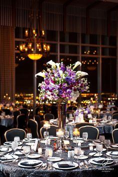 Purple centerpiece flowers. Photography by Adam Nyholt, Photographer.