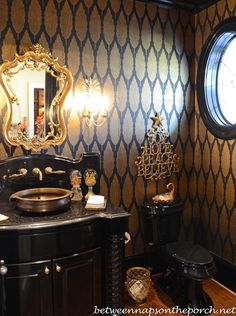 Elegant black and gold powder room in the Georgia home of Governor Roy Barnes and his wife Marie.