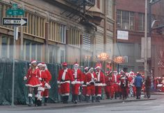 """Santacon, Portland, Oregon....  I would really love to do this, I hear it gets pretty out of hand tho. Like pubs put up signs """"Drunk Santas Not Welcome Here""""   hee hee!"""