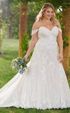 D2525 by Essense of Australia. Ideal for the classic and sophisticated bride, this formal-feeling A-line plus-size wedding dress is the epitome of romance. Designed with a modern and figure-flattering shape, the bodice of this plus-size wedding gown features a delicate sweetheart neckline, accentuated on each side by draping, off-the-shoulder sleeves. The back of this beautiful gown's bodice features sheer, lace paneling that coordinates with the lace that extends down the length of the skirt.