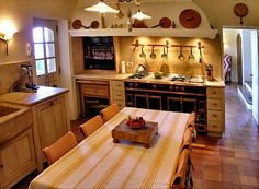 French Country Kitchen design elements: the copper pieces above the integrated hood, at one with the architecture of the room. The built in rotisserie and fabulous cooking center. A rustic sink and rustic built in/inset cabinetry. Sourced via | Le Tour de France - French Country Kitchens — The Kitchen Designer