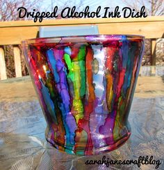 Alcohol ink diy craft tutorial: dripped alcohol ink on glass to create a stained glass effect.
