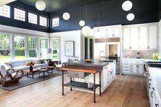 Unique open concept kitchen with high ceiling.